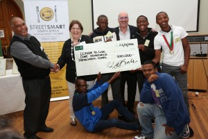 Left to Right Rodney Abrahamse (Learn to Live), Madelein Thornhill (Learn to Live) Leonard Hersch (StreetSmart) with young boys from the Learn to Live panel beating programmeHR