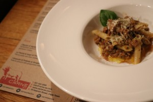 Penne with lamb ragu table setting HR
